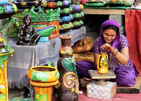 mitacmaitra woman in purple colored pots Pixabay